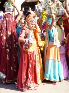 Procession of local girls in their saris