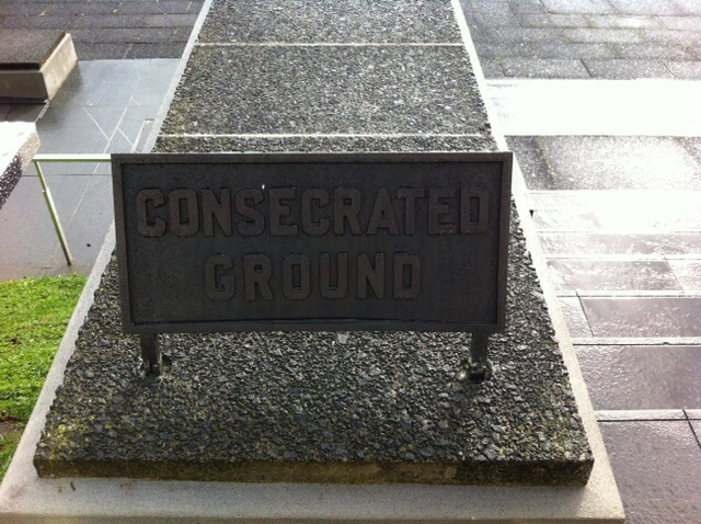 Sign outside the museum saying Consecrated Ground