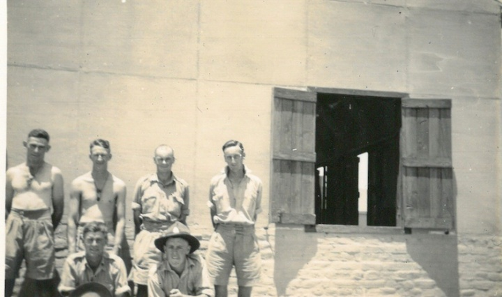 Boys outside hut at Maadi