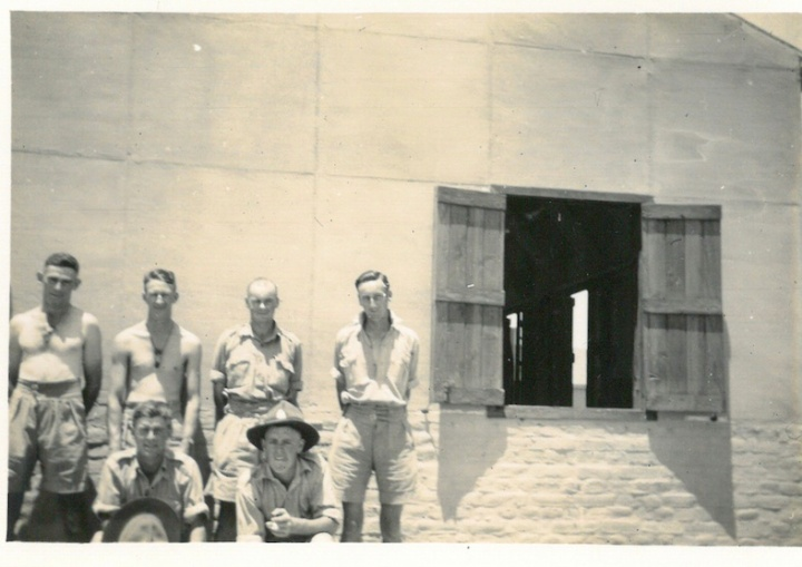Boys outside hut at Maadi