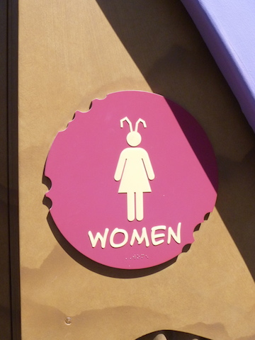 The sign for the women's bathroom - with a bug theme