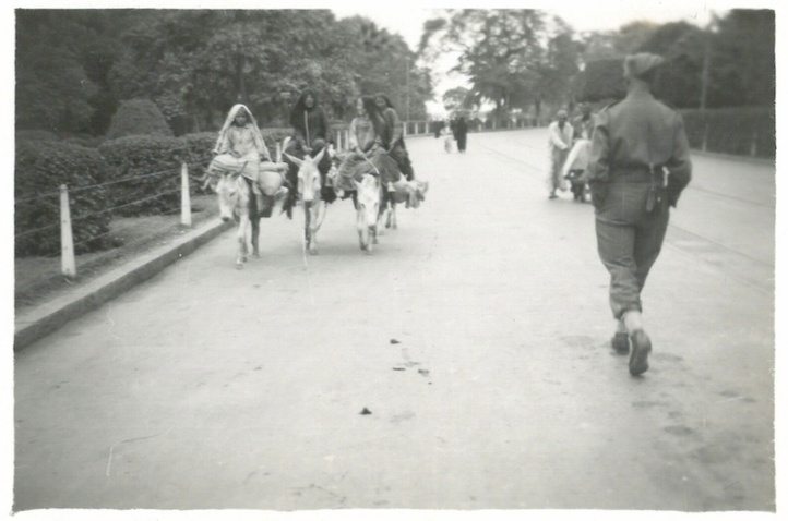 Women Riding Donkeys
