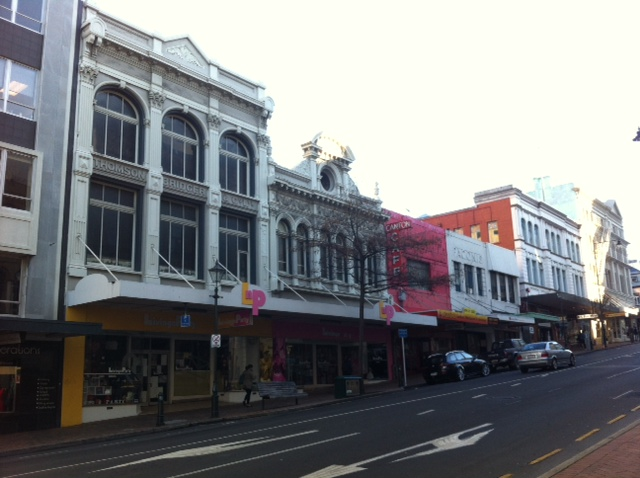 Row of shops with overhead canopies - can't see them lasting following the Canterbury earthquakes