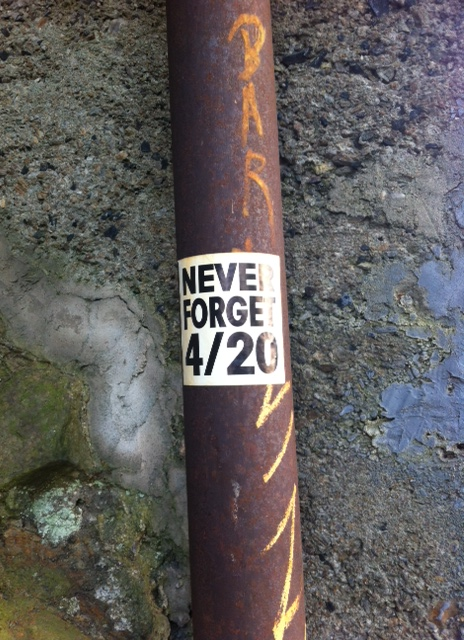 """Sticker on a pole that says """"Never Forget 4/20"""" - I have no idea what this means"""