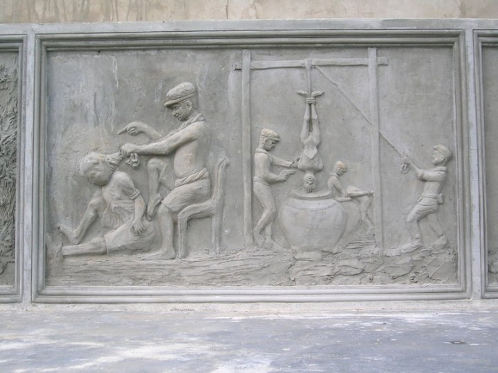 Image carved into the memorial showing some of the torture methods