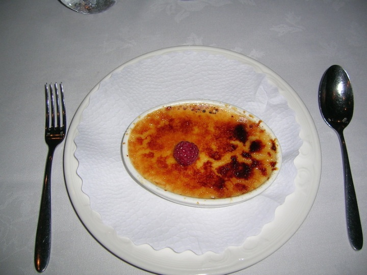 Creme Brulee with seasonal berry (singular)