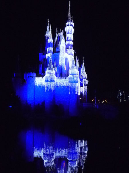 Cinderella's Castle at the Magic Kingdom is lit up at night with lights to look like icicles - so pretty!