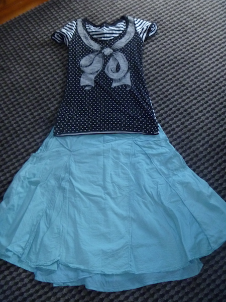 Patterned wear-once-and-leave t-shirt again with the teal skirt.