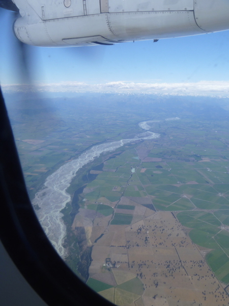 Flying south we flew over the patchwork of the Canterbury plains and braided rivers, spying the Southern Alps in the distance ...