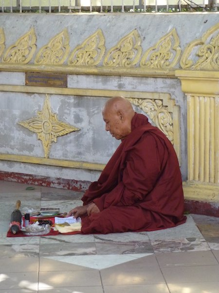 A monk in his burgundy robes