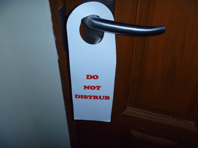 "The ""Do not Distrub"" sign at the hotel"