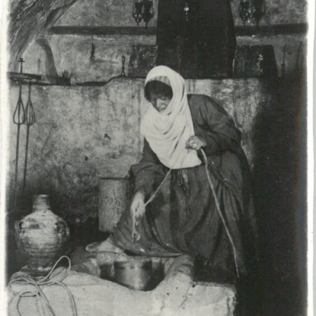 Native woman drawing water from Mary's Well - Nazareth