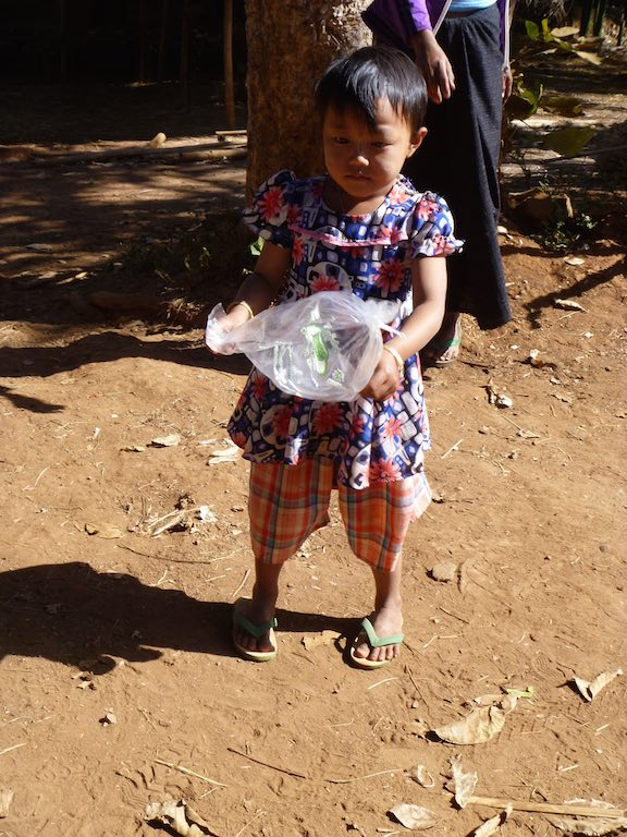 This little girl was playing with this plastic bag - I missed snapping the photo of her with it over her head (yikes!)